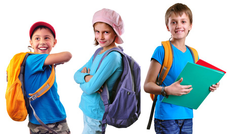 positive feelings: Portrait of three smiling pupils of grade school with backpacks and books posing. Isolated over white background. Education childhood concept