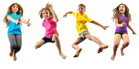 Group of happy children jumping and having fun isolated over white. Childhood, happiness, active lifestyle concept Standard-Bild