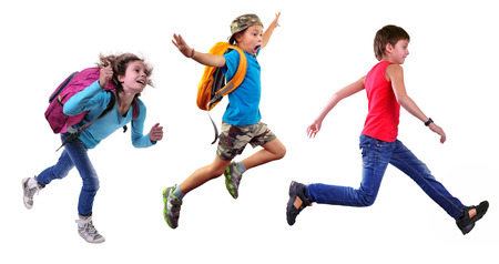 Group portrait of happy schoolgirl and schoolboys with a backpacks  running and jumping together. Isolated over white background. Education childhood concept Archivio Fotografico