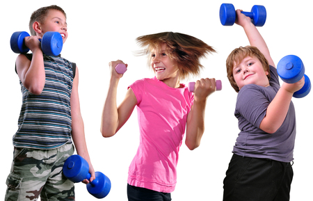 Isolated portrait of children exercising with dumbbells. Childhood, sports, strength active lifestyle concept photo