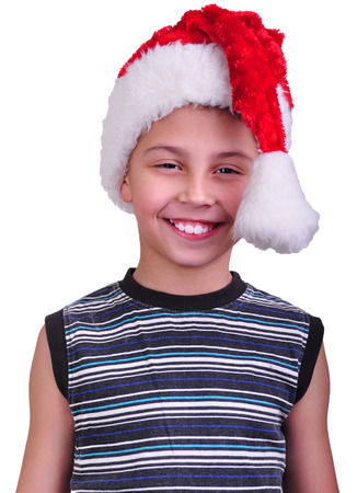 Child with Santa Claus red hat. Christmas, New Year  holiday celebration photo