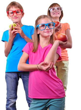 Group of children with apples wearing eyeglasses isolated over white photo