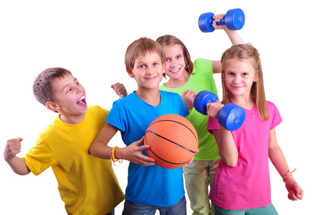 Group of sporty children friends with dumbbels and ball isolated over white . Childhood, happiness, active sports lifestyle concept