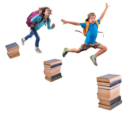 Portrait of a schoolchildren with backpacks leaping over piles of books. Childhood, education, learning concept photo