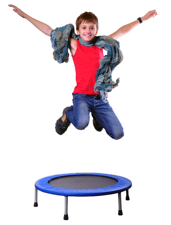 Portrait of a cute  sportive, cheerful happy boy  jumping and dancing on trampoline. Childhood, freedom, happiness concept.