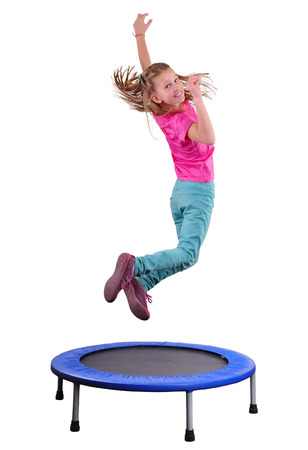 Portrait of a cute  sportive, cheerful happy kid  jumping and dancing on trampoline. Childhood, freedom, happiness concept. Standard-Bild