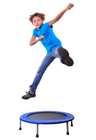 trampoline: Portrait of a cute  sportive, cheerful happy kid  jumping and dancing on batut. Childhood, freedom, happiness concept. Stock Photo