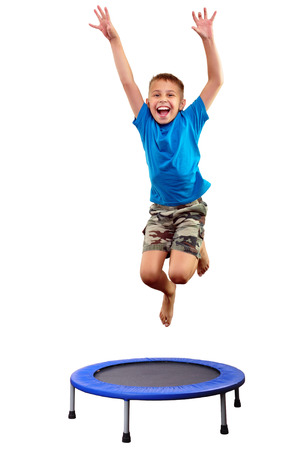 Portrait of a cute  sportive, cheerful happy kid  jumping and dancing on batut. Childhood, freedom, happiness concept. Standard-Bild