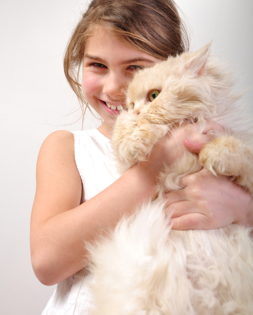 portrait of a cute girl hugging her cat photo