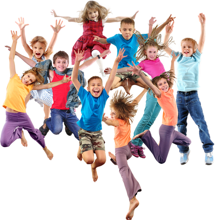 Large group of happy cheerful sportive children jumping, sporting and dancing. Isolated over white background. Childhood, freedom, happiness, active lifestyle concept. Stockfoto