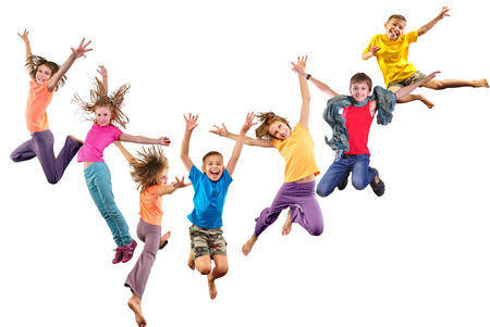 caucasian: Large group of happy cheerful sportive children jumping and dancing. Isolated over white background. Childhood, freedom, happiness concept.