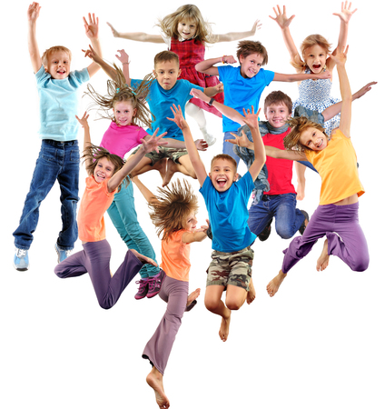 Large group of happy cheerful sportive children jumping, sporting and dancing. Isolated over white background. Childhood, freedom, happiness, active lifestyle concept. Standard-Bild
