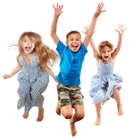 group of barefeet children shouting screaming jumping dancing. Isolated over white background. Childhood, freedom, happiness, active lifestyle concept. Young jumpers kids girls an? boy Standard-Bild
