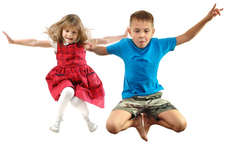 jumpers: children looking down jumping falling. Isolated over white background. Childhood, freedom, happiness, active lifestyle concept. Young jumpers kids girls an boy fall down. Children look down Stock Photo