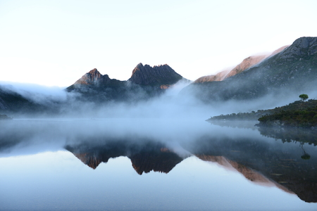 miror: The reflex of Cradle Mountain on the surface of Dove lake during morning at Cradle Mountain-Lake Saint Clair National Park, Tasmania, Australia