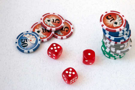 Tokens, poker chips and playing cubes on a white background, with the number five and a unit Stock Photo - 128056207