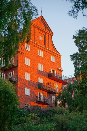 fasade: Stockholm, Sweden - Aug 8, 2016 -House in evening sun.