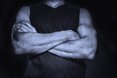 Man with foulded arms.