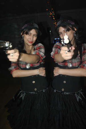 Funny girl with a pistol