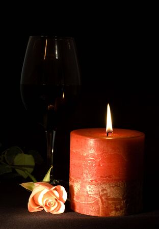 Still-life with glass of wine  , rose and candle Stock Photo - 2752464
