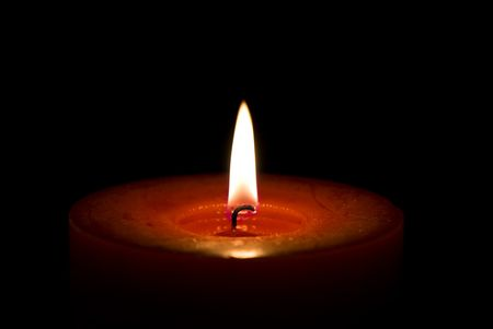 Red candle isolated on a black