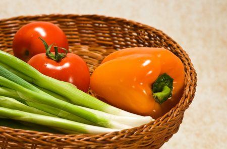 Fresh vegetables in a straw basket