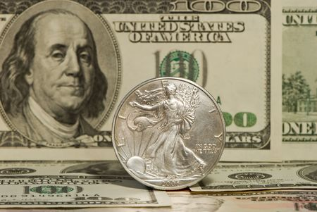 The American silver dollar on a background of bank-paper photo