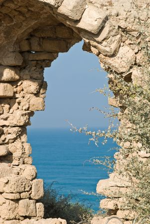 fragment of  ancient arch on the mediterranean sea in Israel photo