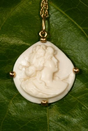chainlet: close-up of Antique Cameo isolated on a green background Stock Photo