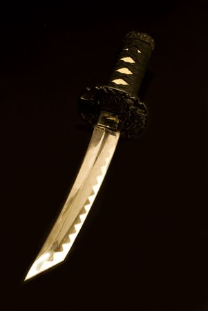 small japanese sword isolated on black background Stock Photo - 3244513