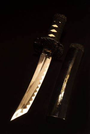 small japanese sword isolated on black background Stock Photo - 3244519
