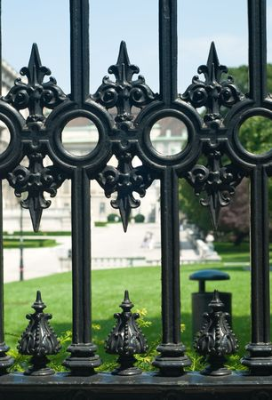 baroque gate: fragment of the decorative fence in Vien park Stock Photo