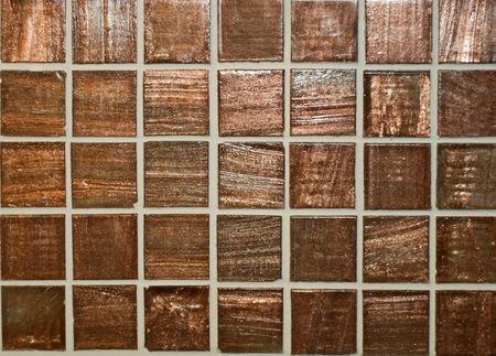 deep brown mosaic on a wall  Stock Photo