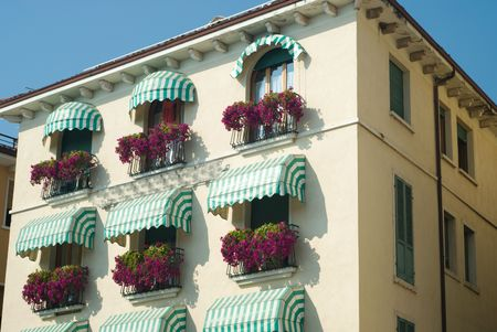 beautiful house with lot of  flowers and awnings Stockfoto