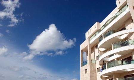 fragment of the modern building on a background of blue sky