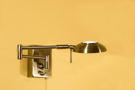 wall sconce: decorative glowing metallic sconce on a wall