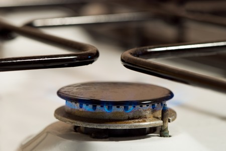 power operated: Kitchen gas burner with blue flame.