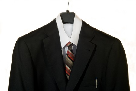 silk wool: business man suit with colored tie over white background