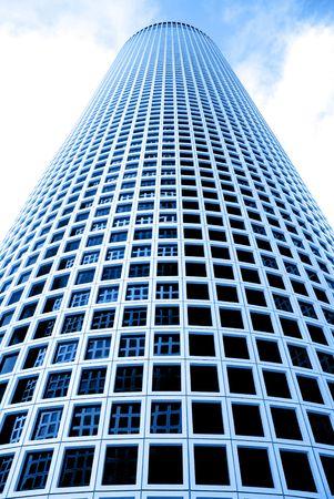 azrieli tower: Round skyscraper over a sky background