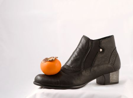 heelpiece: woman fashion boot and fruit Stock Photo