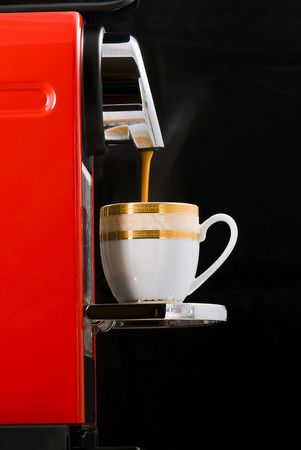 Espresso coffee machine over black background photo