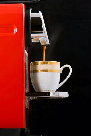 Espresso coffee machine over black background