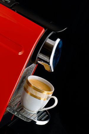 Espresso coffee machine over black background photo