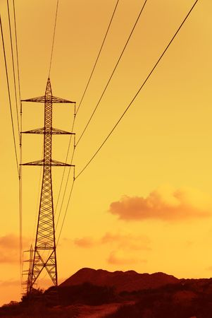silhouette of electric tower ower sunset sky photo