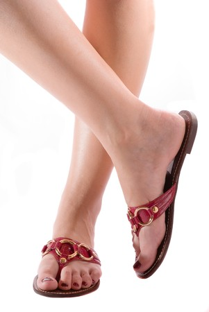 clasp feet: Woman legs on a white background with stylish shoes