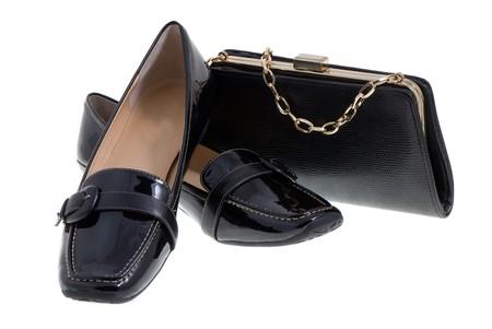 elegant ladys shoes and handbag over white photo