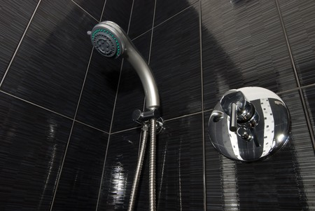 closeup of shower and faucet in the bathroom Stock Photo