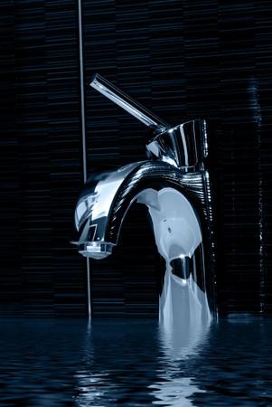 closeup of chrome bathroom faucet Stockfoto