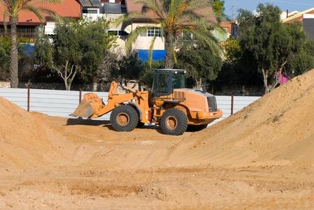 Bulldozer in the road building photo