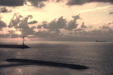 sunset over mediterranean sea in sepia photo